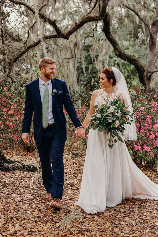 Wedding Planning - couple holding hands under the Spanish moss