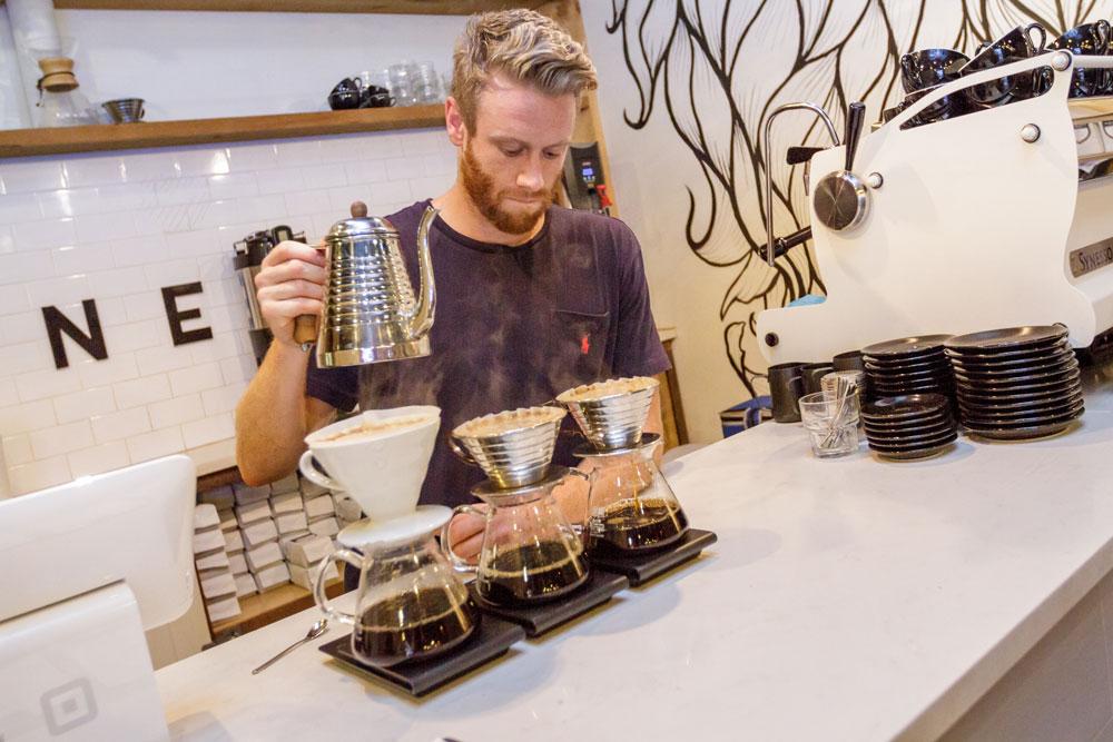 Barista serving fresh coffee